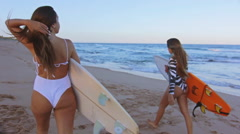 Surf Lifestyle With Two Beautiful Surfers Walking In The Shore At The Beach Stock Footage