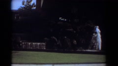 1967: a moving clip that shows an exotic place with many water fountains  Stock Footage