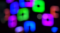 Blurred christmas LED lights adorns the facade of the high-rise building Stock Footage