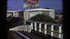 1967: a small bird sits on a power line near a motel SYDNEY AUSTRALIA Stock Footage