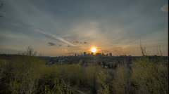 HDR time lapse of sun setting over city in alberta Stock Footage