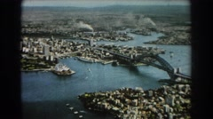 1967: bridge connects densely populated areas covered with buildings  Stock Footage
