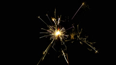 Sparkler, burning from top to bottom, on black background. Stock Footage