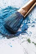 Eyeshadow with brush scattered on white background Stock Photos