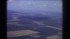 1967: airplane viewing of a normal field and city. BRISBANE AUSTRALIA Stock Footage