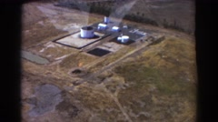 1967: a person, on a jet plane, is filming an oil refinement area. BRISBANE Stock Footage