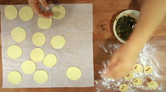 Folding the dough Shish Barak with Yoghurt Recipe Stock Footage