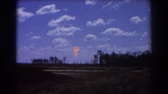 1967: open space with sparse trees and a flame going up BRISBANE AUSTRALIA Stock Footage