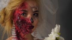 The grim look dead bride on a white orchid Stock Footage