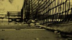 Close Up Establishing Shot of Tennis Court net in autumn - Sepia Stock Footage