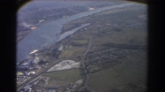 1967: aerial view of city to include landmarks and water BRISBANE AUSTRALIA Stock Footage