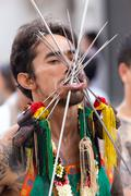 Taoist devotee extreme piercing Stock Photos