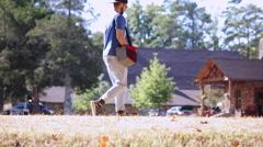 Young Man or Teen Walks to Retrieve Disc Golf Disc Stock Footage