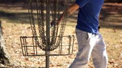 Disc Golf Basket Toss and Retrieve Stock Footage