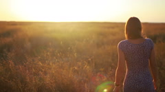 Slow motion departeth female silhouette at sunset Stock Footage