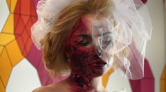 A person disguised in a dead bride blonde Stock Footage