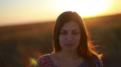 Slow motion portrait of a dark blond young woman calmly looking to the camera Stock Footage