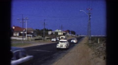1967: cars going by on a quiet road in the suburbs PERTH AUSTRALIA Stock Footage