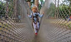 Little girl overcomes obstacles. Stock Photos