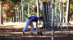 Young Man or Teen Putts and Retrieves Disc Golf Disc Stock Footage