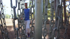 Young Man or Teen Retrieves His Disc Golf Disc from Basket Stock Footage