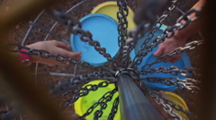 Overhead Shot, Golfers Retrieving Disc Golf Discs from Basket Simultaneously Stock Footage