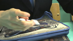 The schoolboy collects pencil case at the class Stock Footage