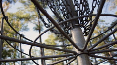 Low Angle, Disc Golf Discs Lanidng in Basket Stock Footage
