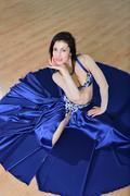 Beautiful woman in arabic costume dancing in motion, oriental or belly dance Stock Photos