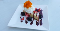 Key Lime Pie Dessert with Wipe Cream with Fruit Sauce on Plate, 4K Stock Footage