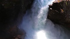 Flowing water at the rocky waterfall close up Stock Footage