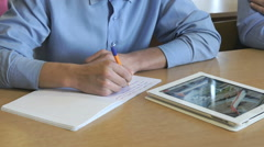 Schoolboy looks at the information using a tablet Stock Footage