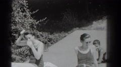1937: women and children relax on a beach. SOUTHAMPTON NEW YORK Stock Footage