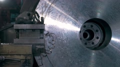 Rotating shiny metal part of the CNC lathe, machine shop, modern factory Stock Footage