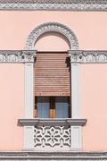 Decorated door window of an Italian neoclassical villa. Stock Photos