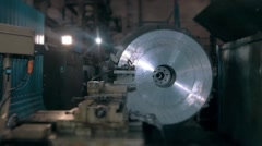 Rolls of material for production of details at factory, metal machine shop Stock Footage