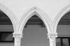 Cloister with Gothic arches and  columns. Stock Photos