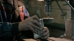 Craftsman sawing metal with disk grinder in workshop, modern iron factory Stock Footage