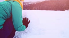 Cheerful Woman Building a Snowman, Enjoying Winter. STABILIZED SLOW-MO 120fps. Stock Footage