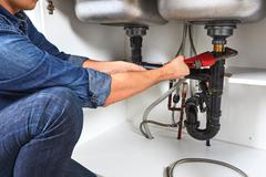 Plumber with wrench. Stock Photos