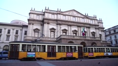 Old orange trams in front of the Scala Theatre Stock Footage
