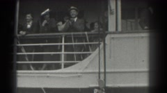 1939: people on the deck of a boat filming those on shore while awaiting to set Stock Footage