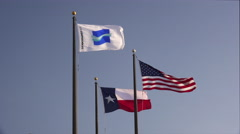 Port Corpus Christi Flag Flies with American and Texas Flag Stock Footage