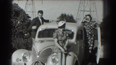 1939: mother, son, and daughter pose on the car for photos. SAN FRANCISCO Stock Footage