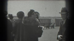 1939: people dressed to resist the cold weather and standing together  Stock Footage