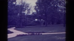 1938: a large, well manicured yard stretches out from a white mansion ATLANTIC Stock Footage