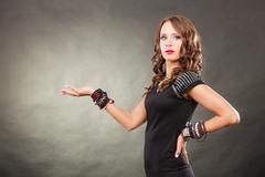 Elegant woman wearing bracelets holds open hand Stock Photos