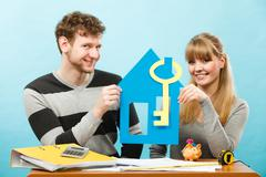Happy couple dreaming about house. Stock Photos