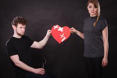 Sad woman and man addicted to alcohol. Broken heart. Stock Photos