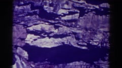 1938: rocky outcropping with a waterfall running through BLACKWATER FALLS  Stock Footage